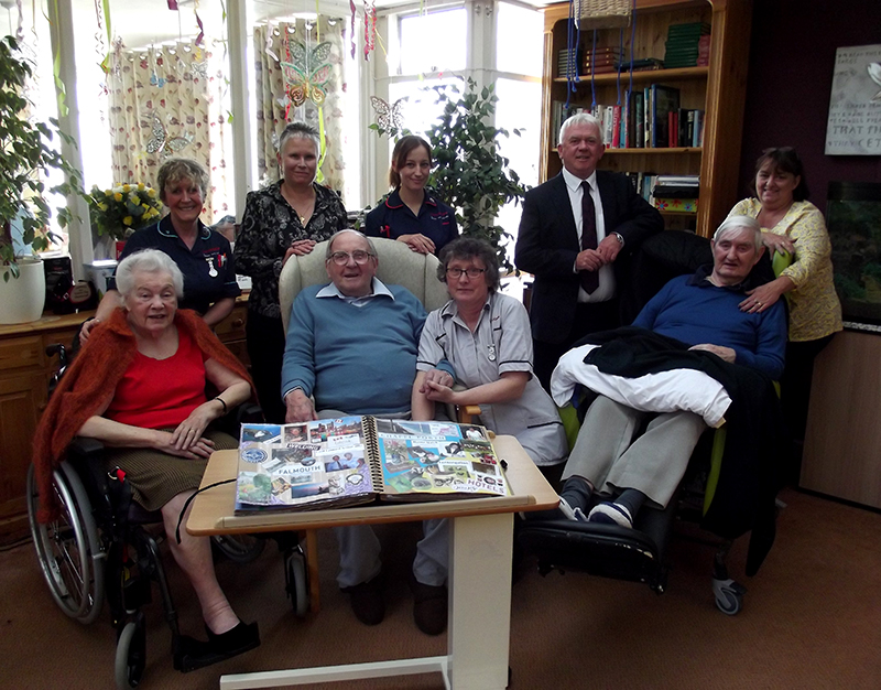 Mountford GSF - Group with memory book (800w).jpg